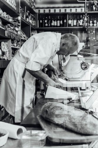 A look Inside an italian butchery in Rome Italy. Notice the reflection of the famous monuments in the right bottom corner.