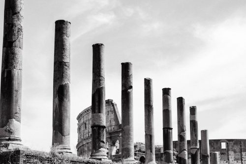 The road from forum romanum to the colosseum lined with pillars