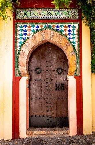 Gateway door in Granada, opposite hill of the Alhambra