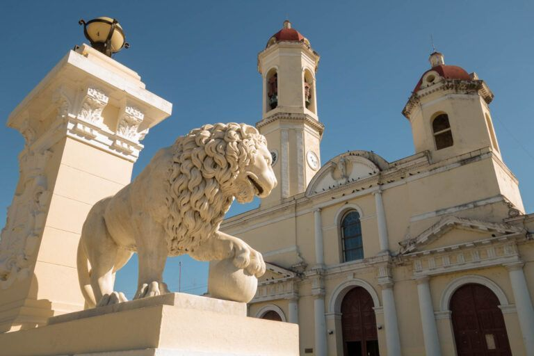 Cienfuegos, Cuba. On the main plaza a lion guarding the church