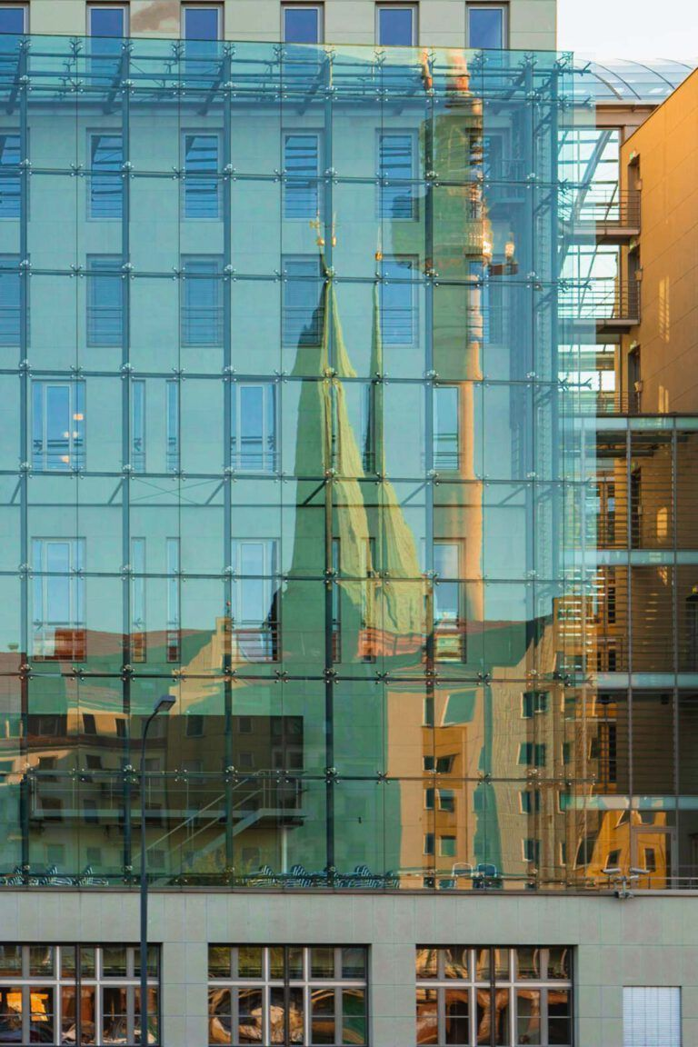 Reflection of the famous Berlin skyline in the newer office buildings along the River Spree