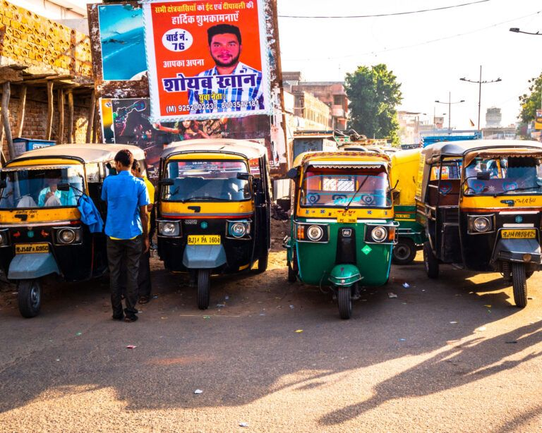 Four street taxis awaiting clients on the streets of jaipur